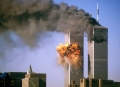 """ATTENTION EDITORS - THIS FILE PICTURE IS ONE OF 83 TO ACCOMPANY THE TENTH ANNIVERSARY OF THE SEPTEMBER 11 ATTACKS. SEARCH FOR KEYWORD """"9/11"""" TO SEE ALL THE IMAGES (PXP901-PXP983)  The south tower of the World Trade Center bursts into flames after being struck by United Airlines Flight 175 in New York in this September 11, 2001 file photo. September 11th marks the 10th anniversary of the 9/11 attacks where nearly 3,000 people died when four hijacked airliners were used in coordinated strikes on the Pentagon and the World Trade Center towers. The fourth plane crashed in Pennsylvania. REUTERS/Sean Adair/Files  (UNITED STATES - Tags: CRIME DISASTER ANNIVERSARY)"""